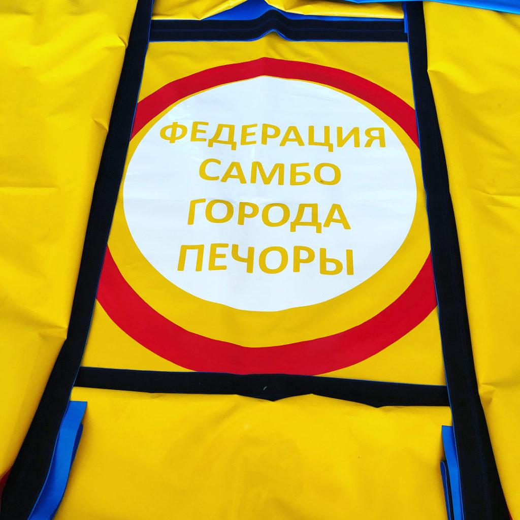 Нанесение логотипов на борцовские ковры от РОССАМБО
